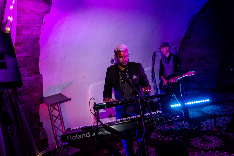 Tolu Ajayi and Pete Trebble performing with Funk Soul Family at a wedding party